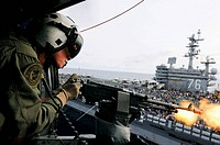 PACIFIC OCEAN (Nov. 21, 2008) Naval Aircrewman 2nd Class Keith Holt fires blank rounds from an M-240 machine gun from an SH-60F Seahawk helicopter ass...