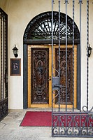 Wrought iron gates and carved wooden door