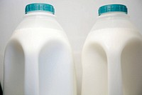 Two plastic bottles of milk