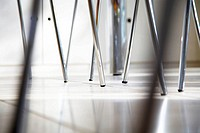 Close-up crop of chrome chair legs