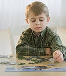 Boy assembling puzzle