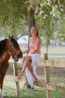 Woman posing with horses