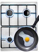 Cooking a fried egg on a gas cooker