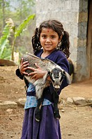 Hindu girl holding her pet goat  Near Besishar, Nepal