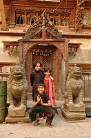 Children posing in front of a temple door  Kathmandu, Nepal