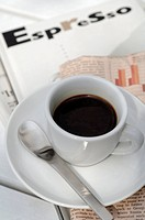 Espresso cup on newspaper