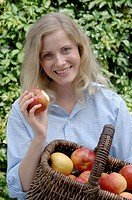 Woman with basket full of apples (thumbnail)