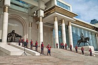 Mongolian soldiers in uniform stand at attention beside Genghis Khan monument, Government House, Ulaan Baatar, Mongolia No releases available