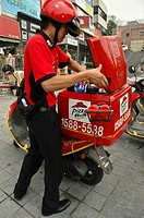 Pizza hut delivery man and scooter Seoul, Korea