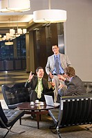 Portrait of multi_ethnic businessmen with laptop in modern lobby