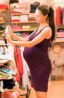 pregnant woman shopping for baby