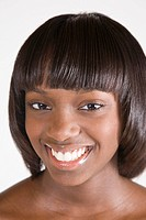 Close_up portrait of young happy African American woman, studio shot