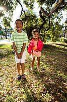 Portrait of African American children in park near tree