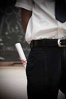 Student with scroll in pocket