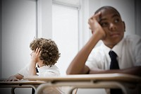 Bored boys in classroom (thumbnail)