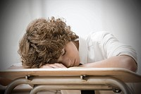 Boy asleep in classroom