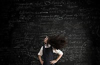 Girl moving in front of blackboard