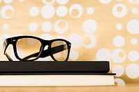 Pair of glasses on books (thumbnail)