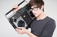 A teenage boy listening to a portable stereo