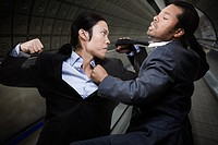 Two businessmen fighting (thumbnail)