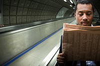 A businessman reading a newspaper (thumbnail)