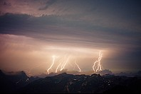Lightning storm over cascade mountains