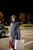 Woman alone in parking lot