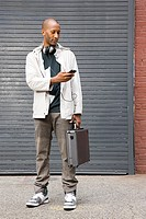Man with cellphone and briefcase