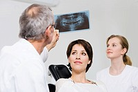 Dentist with patients x_ray