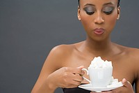 Woman holding a cup of sugar lumps