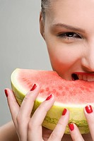Young woman eating watermelon (thumbnail)