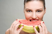 Young woman eating watermelon