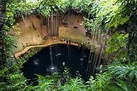 Mexico Yucatan Chichenitza People swimming at Ikil Cenote