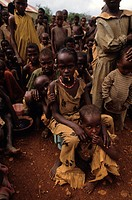 December 16, 1992. Baidoa, Somalia. Children wait in line at a feeding center for their daily meal in an area of Somalia which has been hard it by the...
