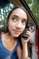 A teenage girl uses an iPhone.