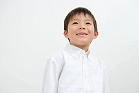 Asian boy smiling and looking up