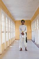 Man standing in a corridor, Meherangarh Fort, Jodhpur, Rajasthan, India
