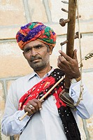 Close_up of a musician playing a musical instrument, Jaisalmer, Rajasthan, India