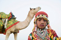 Portrait of a girl with a camel in the background, Jaisalmer, Rajasthan, India