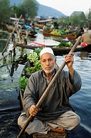 Man selling vegetables in a boat, Dal Lake, Srinagar, Jammu And Kashmir, India