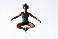 Ballet dancer leaping in mid-air (thumbnail)