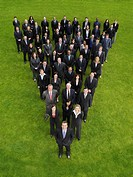 Large group of business people standing in triangle formation elevated view (thumbnail)