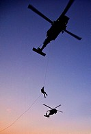 An Air Force Reserve pararescuemen rappels from an HH-60G Pave Hawk during a training mission at Patrick Air Force Base, Fla., March 9 to prepare for ...