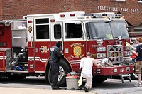 Firefighters polish the fire truck at the Beltsville Vol. Fire Department in Beltsville, Maryland
