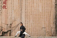 Taoist monk Zhang Qingren demonstrating Tai Ch infront of a famous inscription from Emperor Xuanzong, Hou Shi Wu Temple, Mount Tai, Tai Shan, Shandong...