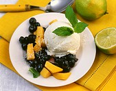 Lime ice cream with mango and blueberry salad