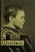 Poland _ Malopolskie voivodship _ Oswiecim. Auschwitz_Birkenau extermination camp UNESCO World Heritage Site, 1979. Child. Photograph at Auschwitz_Bir...