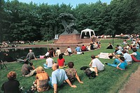Crowd at a park near a statue, Lazienki Park, Historic Centre Of Warsaw, Warsaw, Masovian Voivodeship, Poland