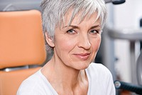 headshot of mature woman in gym