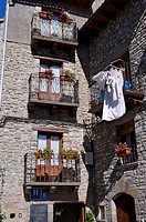 spain, Aragón, Berdun, residence, detail, balconies, flowers, laundry, Europe, village, house, architecture, facade, walls, stone_walls, balcony_doors...